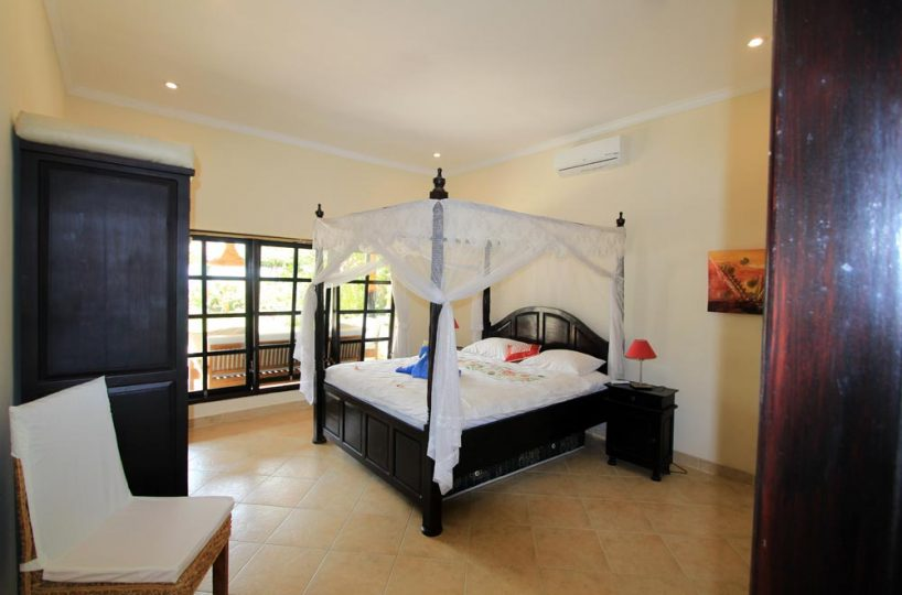 Villa Pantai master bedroom with pool view